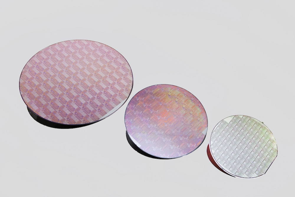 Peregrine Semiconductor's UltraCMOS® technology platform now includes 300 mm wafers. Pictured are wafers from the UltraCMOS 11 technology platform (left), UltraCMOS 10 platform and UltraCMOS silicon on sapphire (right).