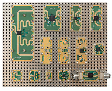 Pictured are Peregrine's RF products as X-MWblock™ components on an X-Microwave prototype plate.