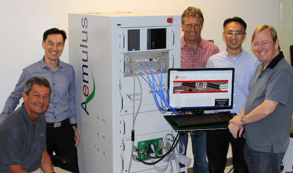Aemulus and Peregrine Semiconductor collaborate on the development of a new microwave frequency tester. Pictured from left to right: Jim Cable, CEO of Peregrine Semiconductor; Sang Beng Ng, CEO of Aemulus; Carl Tulberg, principal engineer, NPI operations at Peregrine; E Chiang Tan, senior marketing director at Aemulus; and Jeff Bartlett, manager, production test development at Peregrine.